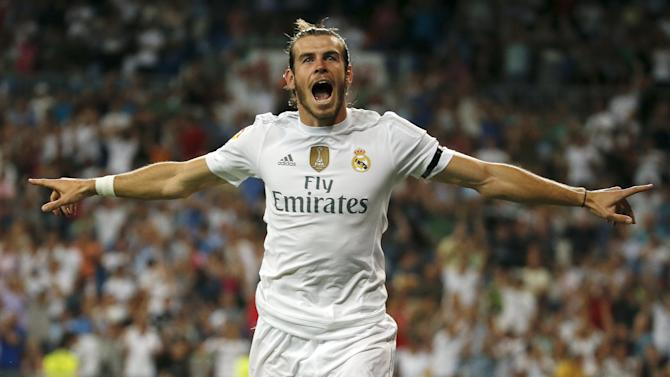 Real Madrid's Bale celebrates his goal against Real Betis during their Spanish first division soccer match at Santiago Bernabeu stadium in Madrid