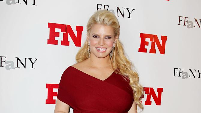 FILE - In this Nov. 29, 2011 file photo, singer Jessica Simpson poses at the 25th Annual Footwear News Achievement Awards at The Museum of Modern Art in New York.  Simpson, who gave birth to daughter Maxwell on May 1, 2012, announced Monday, May 14, 2012, that she is launching a new line of clothing for moms-to-be. (AP Photo/Starpix, Amanda Schwab, File)