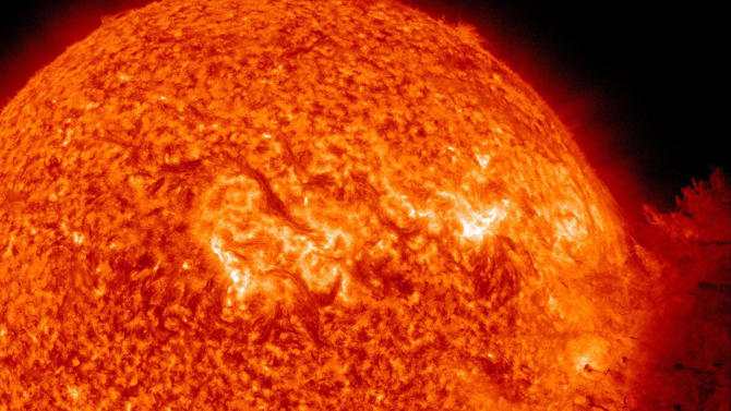This image provided by NASA shows the Sun unleashing a medium-sized solar flare, a minor radiation storm and a spectacular coronal mass ejection on June 7, 2011. The large cloud of particles mushroomed up and fell back down looking as if it covered an area of almost half the solar surface. The ejection should deliver a glancing blow to Earth's magnetic field during the late hours of June 8th or June 9th. High-latitude sky watchers should be alert for auroras when the CME arrives. (AP Photo/NASA)