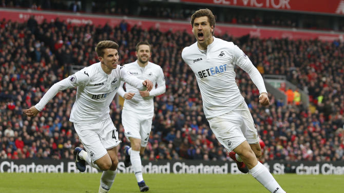 Swansea City's Fernando Llorente celebrates scoring their second goal with Tom Carroll