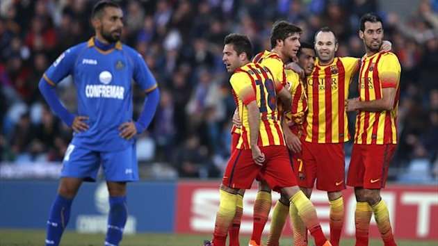 Barcelona's Pedro Rodriguez celebrates his second goal against Getafe with teammates during their Spanish first division soccer match at Coliseum Alfonso Perez stadium in Madrid December 22, 2013. REUTERS