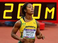 Jamaica's Shelly-Ann Fraser-Pryce competes in the women's 200m heats at the athletics event of the London 2012 Olympic Games in London. Fraser-Pryce stayed on track for an Olympic sprint double on Monday as fellow Jamaican Veronica Campbell-Brown took her first step towards a third consecutive 200m gold
