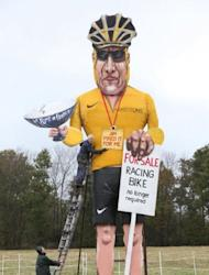 Artist Frank Shepherd of the Edenbridge Bonfire Society puts the finishing touches to a giant effigy of Lance Armstrong in Edenbridge, Kent. The disgraced US cyclist will suffer a fresh humiliation this weekend when the town burns the 30ft guy