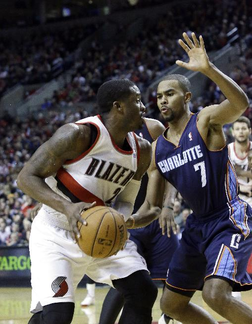 Portland Trails Blazers guard Wesley Matthews, left, looks to shoot against Charlotte Bobcats guard Ramon Sessions during the second half of an NBA basketball game in Portland, Ore., Thursday, Jan. 2, 2014.  Matthews led the Trail Blazers in scoring with 25 points as they won 134-104
