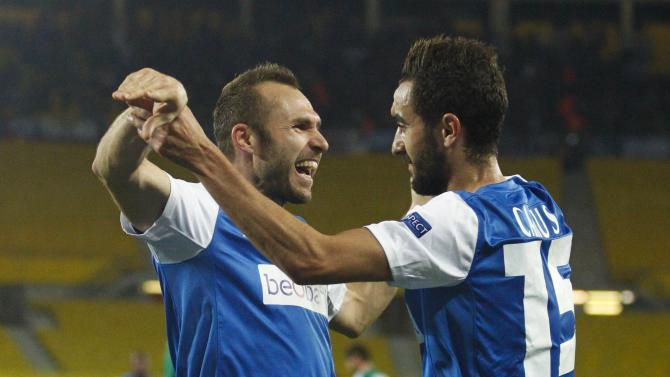 Genk's Buffel celebrate with teammate Camus after scoring a goal against Rapid Vienna during their Europa League soccer match at the Ernst Happel stadium in Vienna