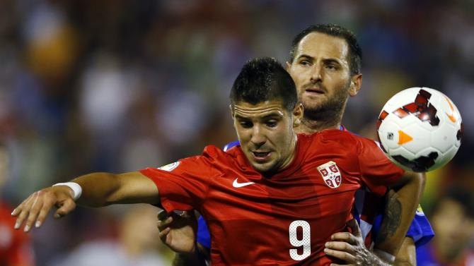 Serbia's Mitrovic challenges Croatia's Simunic during their 2014 World Cup qualifying soccer match in Belgrade