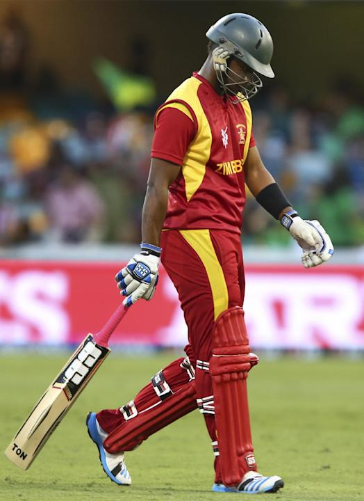 Zimbabwe's Chamunorwa Chibhabha walks back after his dismissal during the Pool B Cricket World Cup match against Pakistan in Brisbane, Australia, Sunday, March 1, 2015. (AP Photo/Tertius Pickard)