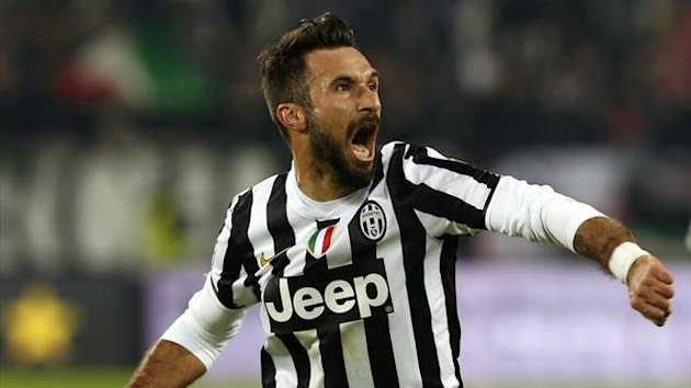 Juventus' Mirko Vucinic celebrates after scoring a penalty against AS Roma during their Italian Serie A soccer match at the Juventus stadium in Turin January 5, 2014 (Reuters)