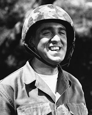 FILE - Jim Nabors is seen in character for his role of Gomer Pyle in this 1966 file photo. Hawaii News Now reports Jim Nabors and his partner, Stan Cadwallader, traveled from their Honolulu home to Seattle to be married Jan. 15, 2013. The couple met in 1975 when Cadwallader was a Honolulu firefighter. The 82-year-old Nabors says you've got to solidify something when you've been together as long as they have. (AP Photo)