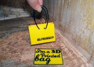 A 3D-printed miniature version of Selfridges' icon shopping bag.