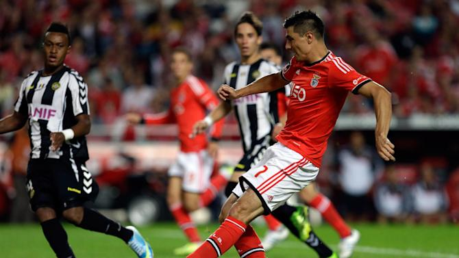 Benfica's Oscar Cardozo, right, shoots to score their second goal during the Portuguese league soccer match against Nacional at Benfica's Luz stadium in Lisbon, Sunday, Oct. 27 2013