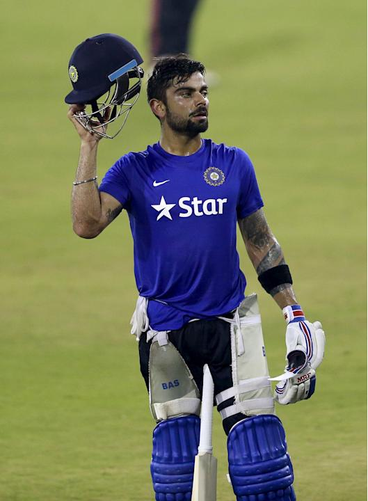 India's Kohli wears a helmet as he prepares to bat in the nets during a practice session ahead of their second Twenty-20 cricket match against South Africa in Cuttack