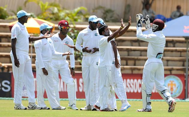 West Indies A team players celebrates after the wicket of India A team, during the unofficial 1st Test Match between India A and West Indies A 3rd day at Gangothri Glades Cricket Ground, in Mysore on
