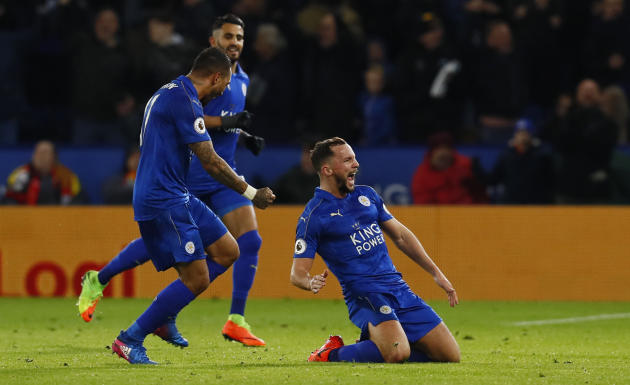 Leicester City's Danny Drinkwater celebrates scoring their second goal with Danny Simpson and Riyad Mahrez
