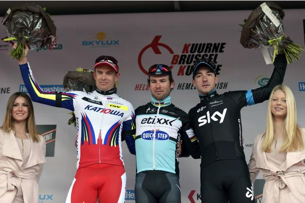 Etixx-Quick-Step rider Mark Cavendish of Britain celebrates on the podium after winning the Kuurne-Brussels-Kuurne cycling race