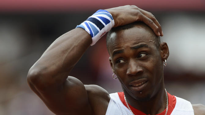 Britain's Phillips Idowu reacts after his jump in the men's triple jump qualification at the London 2012 Olympic Games at the Olympic Stadium