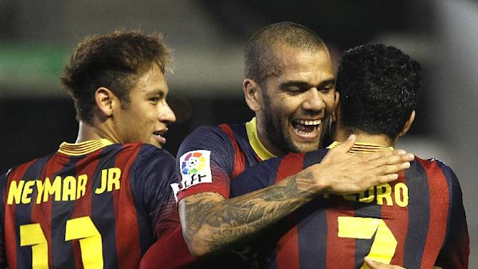 Barcelona's Pedro Rodriguez, right, celebrates with teammate Daniel Alves, center, after scoring against Betis as Neymar, left, looks on during their La Liga soccer match at the Benito Villamarin stadium, in Seville, Spain, Sunday, Nov. 10, 2013