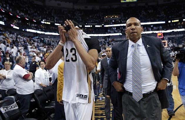 New Orleans Pelicans forward Anthony Davis (23) and head coach Monty Williams walk off the court after Game 4 of a first-round NBA basketball playoff series against the Golden State Warriors in New Or