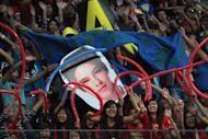 """Daniel Padilla's fans cheer for their idol during Princess and I's """"The Royal Championship"""" basketball game between Team Jao and Team Gino held at the Mall of Asia Arena in Pasay city, south of Manila on 20 January 2012."""
