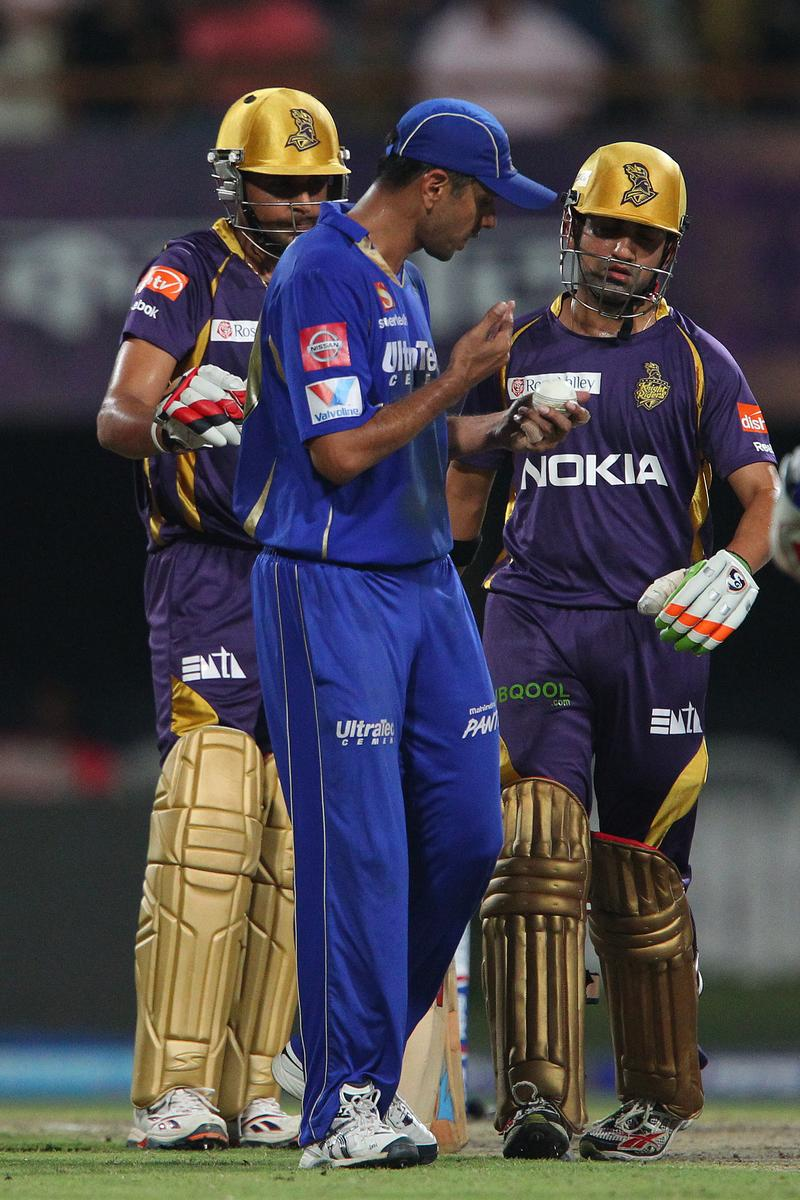 Manvinder Bisla, Rahul Dravid and Gautam Gambhir inspect the ball during match 47 of the Pepsi Indian Premier League between The Kolkata Knight Riders and the Rajasthan Royals held at the Eden Gardens