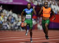 Brazil's Daniel Silva (left) and guide Heitor de Oliveira Sales compete in the men's 200m T11 semi-final at the London Paralympics Games on September 4. Spurred on by Icelandic songstress Bjork, crowds at the London 2012 Paralympics are keeping a lid on their excitement for blind sports that need to be played in silence