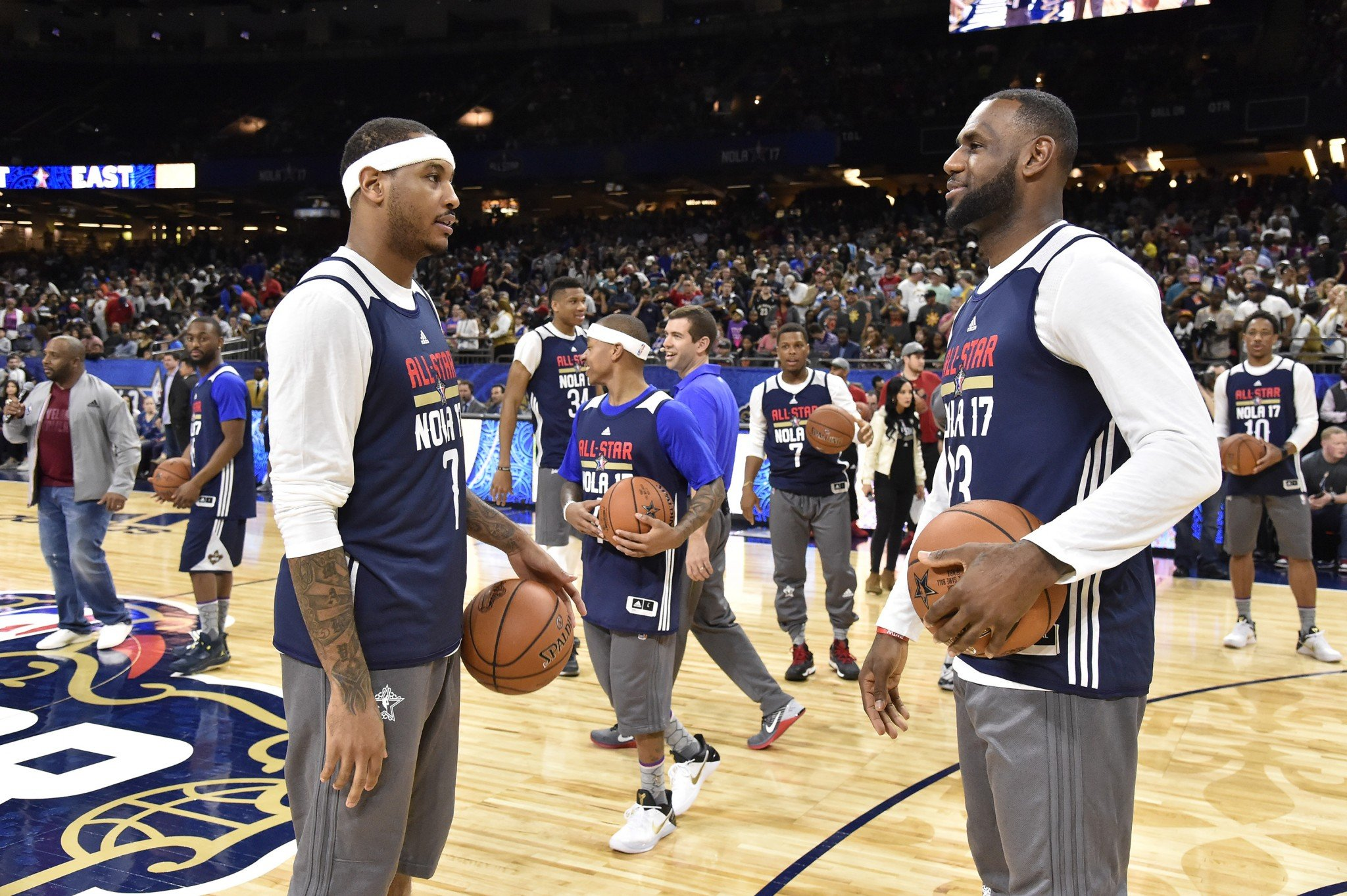 Carmelo Anthony tells good friend LeBron James all about the scourge of non-refundable fares. (Getty Images)