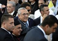 Lebanese President Michel Sleiman (C) arrives to attend a ceremony led by Pope Benedict XVI in the Lebanese mountain village of Bkerke
