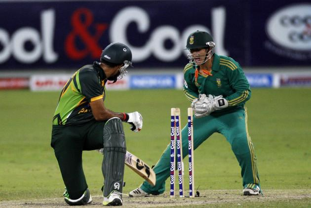 South African Quinton de Kock attempts to stump Pakistan's Sohaib Maqsood during their second Twenty20 international cricket match in Dubai
