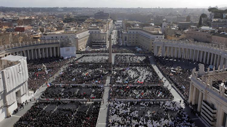 Faithful gather in St. Peter's Square at the Vatican, Tuesday, March 19, 2013. Pope Francis has urged princes, presidents, sheikhs and thousands of ordinary people gathered for his installation Mass to protect God's creation, the weakest and the poorest of the world. (AP Photo/Dmitry Lovetsky)