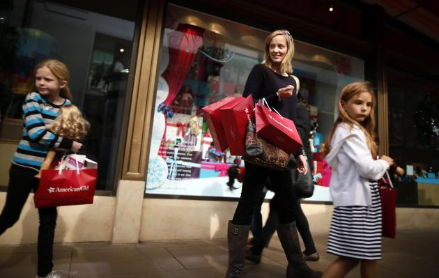 Joanne Bryant, 35, (2nd R) shops with Cariann Bryant, 8, (L) and Katie Sack, 8, at The Grove mall in Los Angeles November 26, 2013. This year, Black Friday starts earlier than ever, with some retailers opening early on Thanksgiving evening. About 140 million people were expected to shop over the four-day weekend, according to the National Retail Federation. REUTERS/Lucy Nicholson (UNITED STATES - Tags: BUSINESS TPX IMAGES OF THE DAY)
