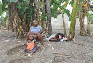 Haitians sit amid their destroyed home and banana grove on November 17 in the Nippes section of Haiti. Hurricane Sandy, the deadly storm that slammed into New York and New Jersey in October, tore through the Caribbean long before reaching America -- and in Haiti, many still await help.