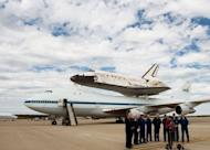 Officials and the crew of the 747 that carried the Space Shuttle Discovery to its retirement home outside Washington speak to reporters
