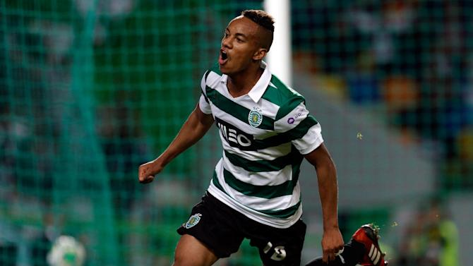 Sporting's Andre Carrillo, from Peru, celebrates after scoring their second goal against Setubal  during their Portuguese league soccer match Saturday, Oct. 5 2013, at Sporting's Alvalade stadium in Lisbon