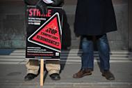 A BBC employee holds a placard outside Broadcasting House in central London on February 18, 2013. BBC journalists staged a 24-hour strike on Monday in protest at job cuts, preventing the transmission of the flagship Today morning news programme and several other television and radio shows