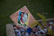 Messages for Nelson Mandela are pictured outside his Johannesburg home on June 9, 2013. Nelson Mandela remained under intensive care at a Pretoria hospital for a fifth day Wednesday battling a potentially deadly lung infection