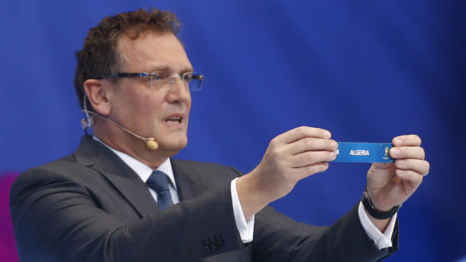 FIFA Secretary General Jerome Valcke holds the ticket of Algeria during the draw ceremony for the 2014 soccer World Cup in Costa do Sauipe near Salvador, Brazil, Friday, Dec. 6, 2013