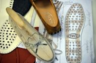 Drawings of moccasin prototypes are displayed in the workshop of the Italian shoes and luxury leather goods maker Tod's on May 27, 2013 in Casette d'Ete in the Italian Marche region