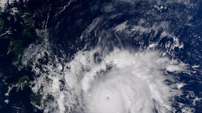 This Earth Observatory image made on Dec. 3, 2012, provided by NASA shows Typhoon Bopha moving toward the Philippines. Typhoon Bopha slammed into the Davao region of the Philippines early Tuesday, Dec. 4, killing at least seven people and forcing more than 50,000 to flee from inundated villages. (AP Photo/NASA, Jesse Allen)