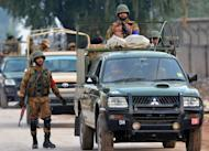 Army personnel gather outside Peshawar airport in Peshawar, northwest Pakistan, on December 16, 2012 after it was attacked by militants late Saturday. Six people were killed Sunday as police and troops battled militants armed with automatic weapons, grenades and mortars in Peshawar, a day after a deadly Taliban raid on the city's airport