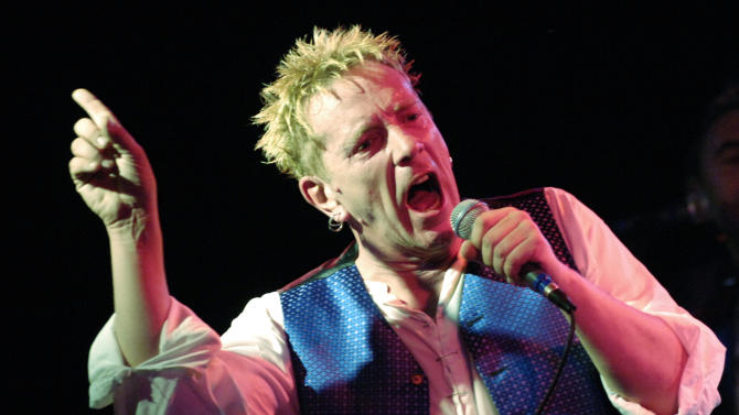 """FILE -  This is a Thursday, Oct. 25, 2007 file photo of John Lydon  as performs with The Sex Pistols at the Roxy in West Hollywood, Calif., The concert marked the legendary British punk band's first-ever club performance in Southern California.  A 70-year-old song is giving the BBC a headache, as it decides whether to play """"Ding Dong! The Witch is Dead"""" _ a song from the """"Wizard of Oz"""" being driven up the charts by opponents of Margaret Thatcher as a mocking memorial to the late prime minister,  It's not the first time Britain's national broadcaster has been caught in a bind about whether to ban a song on grounds of language, politics, or taste.  And the broadcaster _ nicknamed """"Auntie"""" for its """"we-know-what's-good-for-you"""" attitude  usually comes under fire, whatever it does. The Sex Pistol song """"God Save the Queen"""" was banned by the BBC. (AP Photo/Chris Pizzello, File)"""