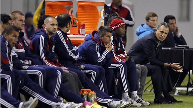 Chivas USA head coach Jose Luis Real, right, talks to his bench with his team playing against Portland Timbers during the second half of an MLS soccer match, Saturday, Oct. 26, 2013, in Carson, Calif. Timbers won the match 5-0