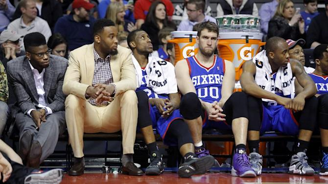 From left, Philadelphia 76ers center Nerlens Noel, forward Arnett Moultrie, forward Thaddeus Young, center Spencer Hawes (00) and guard James Anderson sit on the bench during the fourth quarter of an NBA basketball game against the Detroit Pistons on Saturday, Feb. 1, 2014, in Auburn Hills, Mich. Detroit won 113-96