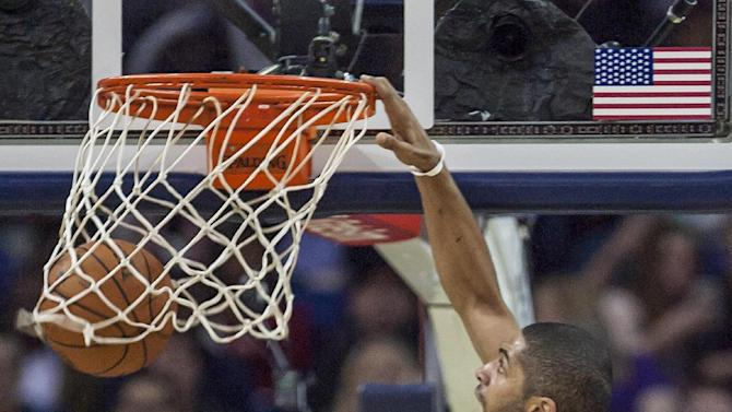 Portland Trail Blazers forward Nicolas Batum (88) dunks against against the New Orleans Pelicans in the second half of an NBA basketball game in New Orleans, Friday, March 14, 2014. The Trail Blazers won 111-103