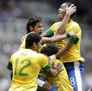 Brazil's Leandro Damiao (hidden) celebrates scoring their third goal against Honduras with Hulk (L), Neymar (2L) and Romulo (R) during a London 2012 Olympic Games men's football quarter final match at St James' Park, Newcastle upon Tyne, England, on August 4, 2012. AFP PHOTO / GRAHAM STUART