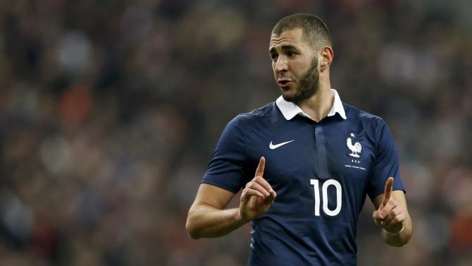 France's Benzema reacts during the international friendly soccer match against the Netherlands at the Stade de France in Saint-Denis