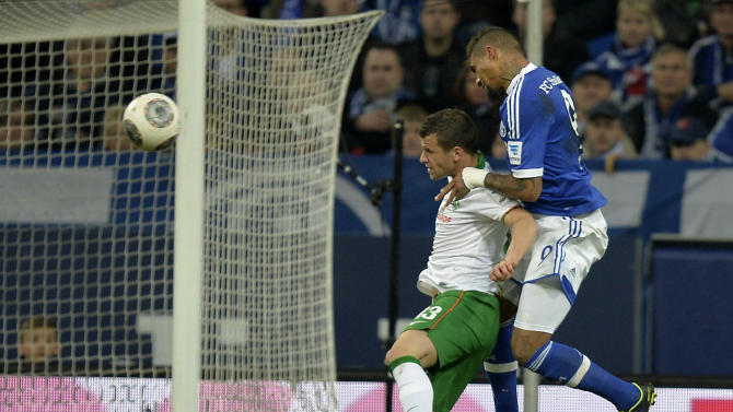 Schalke's Kevin-Prince Boateng, right, scores with a header during the German Bundesliga soccer  match between FC Schalke 04 and  SV Werder Bremen in Gelsenkirchen, Germany, Saturday, Nov. 9, 2013
