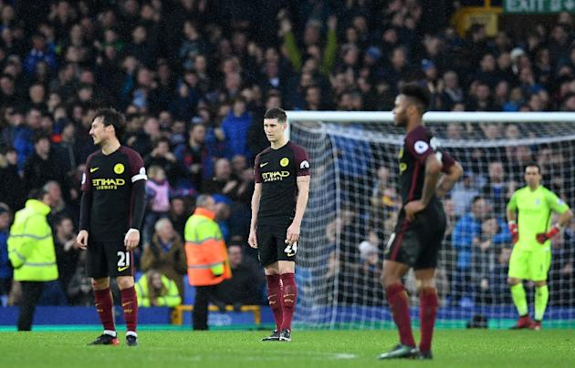 Manchester City players react following their English Premier League loss against Everton, at Goodison Park in Liverpool, on January 15, 2017