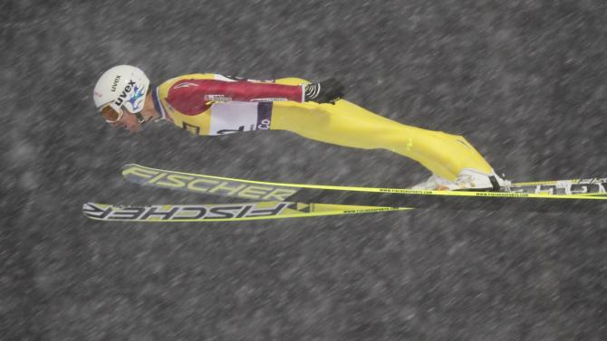Francois Braud of France jumps at the large hill during the FIS Nordic Combined World Cup competition in Lillehammer