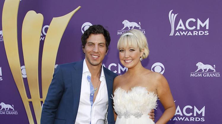 Joshua Scott Jones, left, and Meghan Linsey, of musical group Steel Magnolia, arrive at the 47th Annual Academy of Country Music Awards on Sunday, April 1, 2012 in Las Vegas. (AP Photo/Isaac Brekken)