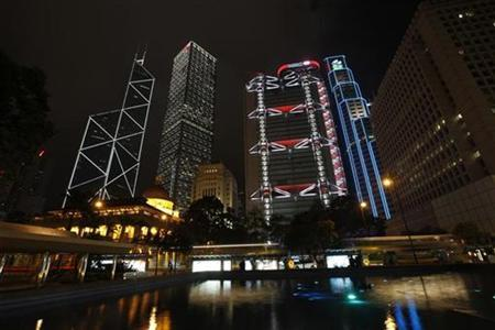 Hong Kong's central financial district's Bank of China Tower, Cheung Kong Centre, HSBC headquarters, Standard Chartered Bank and Legislative Council are pictured lighted up before Earth Hour